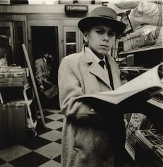 Diane Arbus, 1956, Boy Reading a Magazine