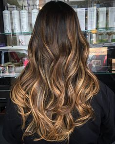 dark brown hair with golden brown ombre highlights