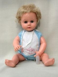 My first Tiny Tears for my 2nd birthday - mine was identical to this but dressed in pink & white gingham, given that she was only made in 1965 I must have been one of the first to have her.  My kid brother drew on her face in biro and it wouldn't come off, I cried and cried.  So for my 10th birthday I was bought my second Tiny Tears in her white nylon dress - I still have her but my daughter never wanted to play with her when she was growing up.