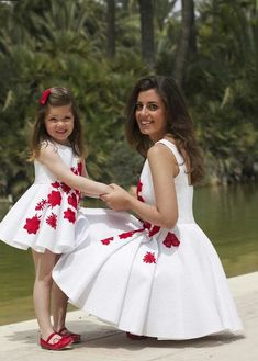 Matching mother and daughter.white dresses with red flowers. Mommy Daughter Dresses, Mother Daughter Matching Outfits, Mother Daughter Fashion, Mommy And Me Outfits, Mom Dress, Family Outfits, Baby Girl Dresses, Kids Outfits, Mother And Daughter Clothes
