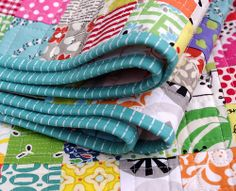 Postage Stamp Quilt -This blog has a tutorial for it.  So great for scraps.