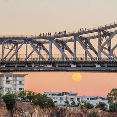 Have you seen tonight's ? Tonight's moon is the largest we've seen since 1948 and this rare phenomenon won't occur again until 2034 🌕 TAG a friend to remind them to look to the sky! Brisbane City, Super Moon, Have You Seen, Sydney Harbour Bridge, City Lights, Australia, Sky, River, Activities