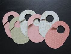 Easily made Closet dividers -- paperboard (like gift boxes or cereal boxes) covered scrapbook paper.  Just put sizes on the hangers and you're done!  Cute idea for add-on to a baby gift.