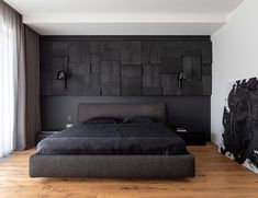 In this modern black bedroom, there's a black wall that provides a backdrop for the matching bed, while a blackened wood panel accent wall adds interest and texture to the room. Design Your Own Bedroom, Black Bedroom Design, Black Master Bedroom, Black White Bedrooms, Black Accent Walls, Black Walls, Accent Wall Bedroom, Bedroom Decor, Wood Panel Walls