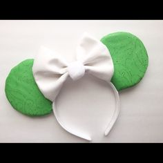 Tinkerbell inspired mouse ears Ears are green colored  fabric with white glittery bow and white puff in the middle ♡  Please keep in mind everything is magically handmade & not all ears are exactly the same & each have there own variations.   All ears are about the same size as the original Disney park ears.   🔴FIRM PRICE  🔴Purchase today, Ship tomorrow  🔴Limited amount available       🔴Also sold on Etsy  🔴Follow on Instagram:@besttrends15 🔴PURCHASE THIS LISTING  (If sold request for a…