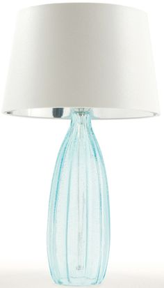 The stunning Bridgeport Aqua Glass Lamp measures H: 29'' • 17'' Dia and features a hard back shade lined in silver and three-way socket.
