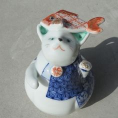 Lucky cat with sea bream