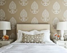 Large scale pattern wallpaper. Bedroom with natural linen headboard with nailhead trim.  I like.