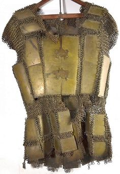 Moro (Philippine) armor, 19th c, brass mail and plate, first worn by warriors during the latter days of Spanish occupation. The Moro are Muslims and are the largest non-Christian group in the country (about 5% of the total population). The Moro Rebellion (1899-1913) was an armed conflict between Moro revolutionary groups in the Mindanao, Sulu, and Palawan (Minsupala) and the U. S. military which took place in the Philippines between 1899 to 1913, following the Spanish-American War in 1898.