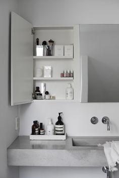 Concrete bathroom with great storage ideas