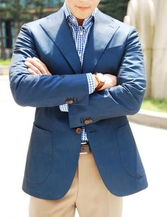 Blue sports jacket, blue/white gingham shirt and dress khakis  - great summer casual look for work or special events.
