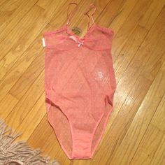 """Honeydew pink sheer body suit BNWT Super sweet, yet sexy. Sheer for the sexiness, lace and bows for the sweet. Full back bottom. Crotch: 2.5"""". Bust: 12"""". Adjustable spaghetti straps. Leg holes: 10"""".  Made of nylon and spandex. Super soft  though and would be able to sleep in.  Plus free gift fur all my buyers as a thank you. I love my customers and they deserve something special. BNWT Abd retails 45$. Middle front to crotch: 16.5"""". Honeydew Intimates & Sleepwear Chemises & Slips"""