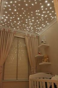 How CUTE is THIS!!     Stars twinkle on the ceiling of this baby nursery putting a twist on the traditional moon and stars nursery theme.