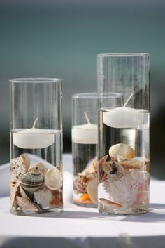 Seashell crafts ideas- hurricane vases with floating candles.