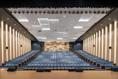 Image 5 of 37 from gallery of Shanghai United International School / Shixian Architects. Photograph by Qingshan Wu Theatrical Scenery, Auditorium Design, Lecture Theatre, Hall Design, Design Design, Graphic Design, Hall Interior, Corporate Office Design, Store Window Displays