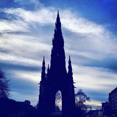 Memories of Scotland: Silhouette of the Scott monument contrasts with a blue white evening sky. by budgettraveller
