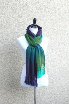 """Hand woven long scarf with gradually changing colors from green to purple. Amazing color shades and color variety. Measures: L: 78"""" with 6"""" fringe on both ends W: 11"""" Care instructions: This scarf mad"""