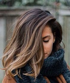 25 Best Hairstyle Ideas For Brown Hair With Highlights: Woman with shoulder length hair and a natural blonde ombre