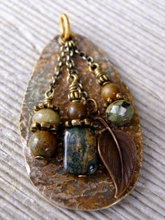 "Brooches and scarf rings/pins would be nice... Hammered Spoon Necklace. Making spoon bracelets for many years. What to do with leftovers? Flatten, pound, patina, add a few pretties, spoon bowl necklace created. Color palette this spoon a dark greenish black with browns. I finished it off with a 27"" antique brass ball chain. You can easily snip the chain if you prefer a shorter length. Shop owneR. kim. Iowa City, IA http://www.etsy.com/listing/155687107/hammered-spoon-necklace?ref=v1_other_2"