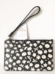 89af9de8cd0 Get the trendiest Clutch of the season! The Coach Small Floral Print Black  And White Wristlet is a top 10 member favorite on Tradesy.