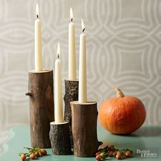 Thanksgiving Candle Displays - Break out the power tools for this DIY fall candle centerpiece. These rustic candle display stands are a bold but gorgeous statement to have in your home. We love the way the wax looks as it drips onto the log base. Easy Fall Crafts, Holiday Crafts, Holiday Decor, Rustic Candleholders, Taper Candles, Table Presentation, Thanksgiving Decorations, Christmas Decorations, Thanksgiving Table