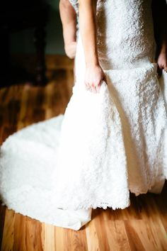 Detailed shot of lace Bridal gown on Wedding day / LEB is weekend wedding destination & barn event venue located in the Texas Hill Country / Photo: J. Violet Photography