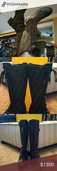 AUTHENTIC FENDI ZUCCA BOOTS FENDI ZUCCA  AND BROWN LEATHER TALL COMBAT BOOTS ! THINK THESE ARE RETIRED!!!  ****NOT SURE IF I WANT TO SELL ***  IN GREAT USED CONDITION ! MISSING 5 GOLD RING STUDS ! SOME SCRATCHES ON THE WOOD PART OF THE HEEL AND ON THE SOLID BROWN LEATHER ! THEY ARE THE MOST COMFORTABLE BOOTS EVER!!!! SIZE 37  RUBBER SOLES  THEY ARE MADE SO WELL SO CAN'T WEAR THEM OUT ! Fendi  Shoes Combat & Moto Boots