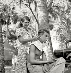 """Fresh Cut: February """"Packinghouse workers in migrant labor camp near Canal Point, Florida. Some of them are from Missouri and Arkansas. No water, no light, no sanitary facilities."""" Photo by Marion Post Wolcott. Vintage Pictures, Old Pictures, Old Photos, Famous Photos, Shorpy Historical Photos, Dust Bowl, Old Florida, Thats The Way, High Resolution Photos"""