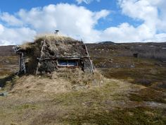 Earthen shelter in Abisko National Park, Sweden.   Photographed by Johann Strube.