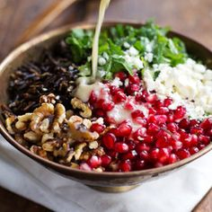 Pomegranate, Kale, and Wild Rice Salad with Walnuts and Feta with homemade dressing. For a fresher  vegan Thanksgiving!