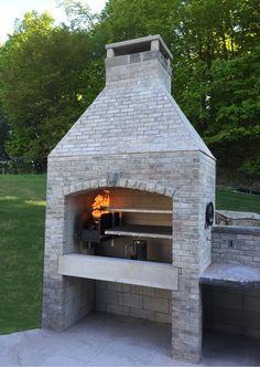 Gaucho Grills Insert in Custom Fireplace