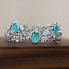 Gübelin's delightful bracelet of the Grace Of The Sea Anemone line. The Paraiba Tourmaline centre stones demand to be admired.