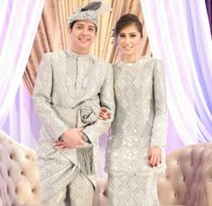 "Cant get enough of these pengantin.. Who are they? Really want to know about them.. They gave the ""SERI PENGANTIN"" to me and looks Sooo SWEET... Songket still the best"