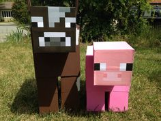 Minecraft Cow and Pig Party Guests: made from a few different sized boxes glued together and painted. I printed the faces to make it easier. The pig was originally going to be a piñata but the park didn't allow it. Instead they were used as decoration. I also brought bow and arrow toys so the kids could hunt for their food ( burgers and hot dogs). These turned out great!