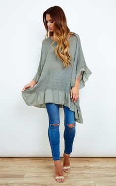 Khaki just keeps on coming and everyone loves it. This oversized top will look great as a dress with heels or over a bikini during the summer months!