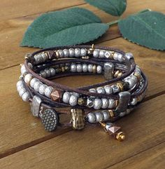 Recognize your freedom to explore earthy boho jewelry with this fabulous Sundance style brown leather wrap bracelet! Reflecting a definite Bohemian influence, this mixed metal wrap is uber current and right on trend. Wear it on its own or as a stacking bracelet joining others of