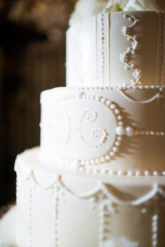 Classic white wedding cake with a monogram (Photo by Eli Turner)