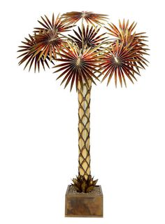 Maison JANSEN, Palm tree floor lamp  Gilded metal, colourless lacquer and red varnish on the nine palm leafs, marble's gravels in a resin bath France, circa 1970 H : 74 51/64 in ; W : 54 21/64 in ; D : 18 7/64 in