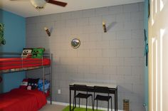 Pictures of my boys' bedroom. I made it over in a Minecraft Theme. Torches were purchased from Think Geek. Wall decals & Minecraft pillows were purchased from Etsy.