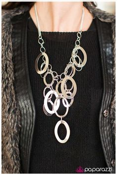 Large silver links and shimmering textured silver rings cascade below a silver chain freely, allowing for movement that makes a bold statement. Features an adjustable clasp closure.   Sold as one individual necklace.Includes one pair of matching earring.    Modeled By: 2016 Life of the Party Member with Platinum Access, Chasity P.