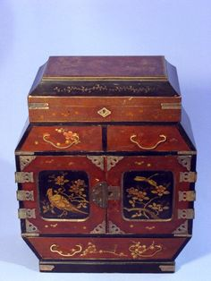 This is a superb antique Japanese table cabinet from the meiji period dating to 1880's  Top lifts to reveal a compartment  with painted design to inside lid, lock to lid (no key)  Fabulous gilt design to the front doors, depicting  flowers and birds  The cabinet contains nine drawers, six of which are behind the decorative doors  Two drawers below lid section  Large gilt decorated drawer to base  Inside doors and small drawers are beautifully decorated with landscape scenes