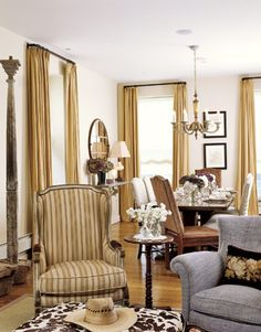 Sheltering armchairs help create a kind of room within a room.