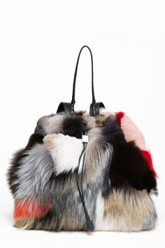 Olsens Unveil New $16,900 Backpack Crafted from Old Coonskin Caps They Dyed with Kool-Aid.
