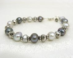 Shimmery grey and silver pearl bracelet. $27.00, via Etsy.