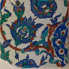 İznik / Date : 2nd half of the 16th century / Technique: Underglaze decoration of plum blossoms, globe artichoke flowers and (half, white) tulips / Dimensions : approximate; 28.5 x 28.5 = 9 finger (Ottoman unit of measurement), 14 mm, 1400gr/