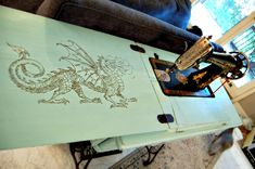 Hand Painted Sewing Machine Table - Reader Feature - The Graphics Fairy http://coopcrafts.com/2014/10/31/painted-singer-treadle-sewing-machine-table/