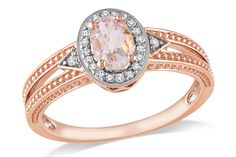 This extraordinary ring features an oval-cut morganite center stone and round white diamond side stones set in 10-karat rose gold. The ring offers a two-tone textured finish