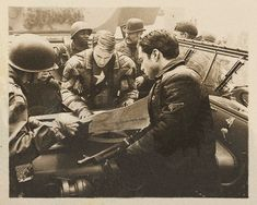 """Cpt. Steven Grant Rogers and Sgt. James Buchanan """"Bucky"""" Barnes of the Howling Commandos (Poland, February 1944)."""
