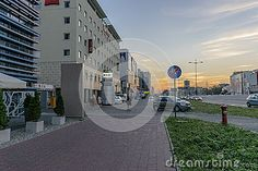 Pilsudki avenue and Modern buildings with hotels in Łódź city in Poland. Evening…