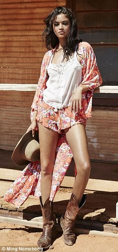Red hot: The mixed-race stunner flashed her toned pins in a pair of printed shorts and cow...